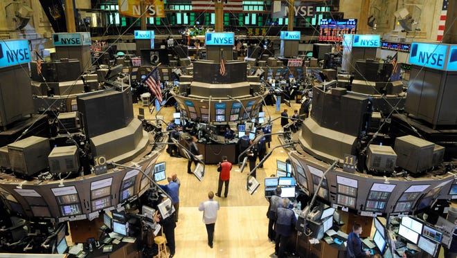 "Traders work on the floor of the New York Stock Exchange on a day when the Dow Jones Industrial Average dropped about 1,000 points, in New York. Computers were blamed for the so-called ""Flash Crash."""
