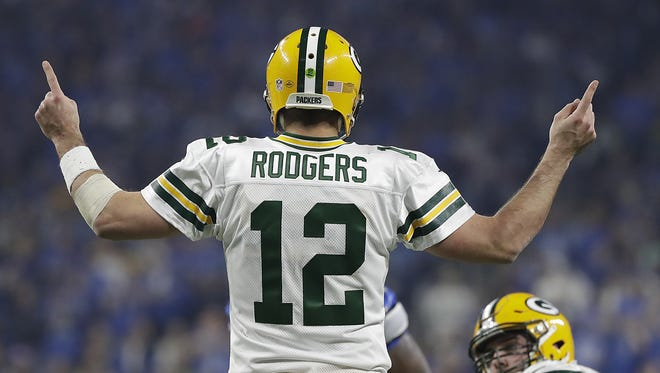 Green Bay Packers quarterback Aaron Rodgers (12) signals at the line of scrimmage against the Detroit Lions at Ford Field.