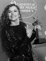 Nicolette Larson gestures to her award during the Academy