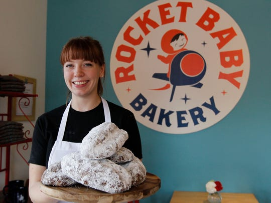 Allie Howard, Rocket Baby Bakery pastry chef, with some freshly baked German stollen in Wauwatosa.