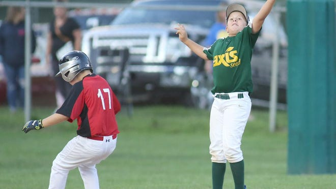 Boonville Ready Mix's Waylon Monteer beats the throw to third while Cade Watring of Axis Seed leaps for the ball in the sixth inning Monday night in Cal Ripken Minor at the COCOBA ballfield at Harley park.