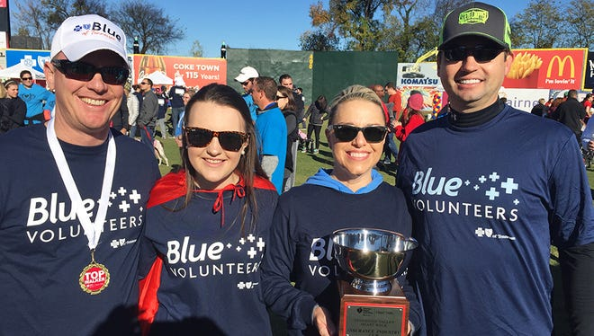 Shelby Givens, second from left, participated in the 2015 Tennessee Valley Heart Walk in Chattanooga in November. Givens walked with her mother, Misty Givens, and nearly 200 BlueCross employees. From left are Doug Smith, Shelby Givens, Misty Givens and Scott Pierce.