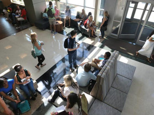Students wait in the lobby for classes and to talk