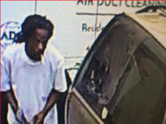 Police are seeking help in identifying this man, pictured near a vehicle used to cart away stolen tools in Menomonee Falls.