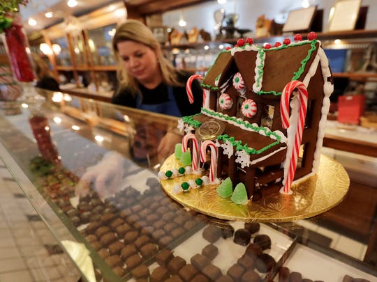A candy house sits atop the chocolate display case at Beerntsen's Candies in Green Bay.