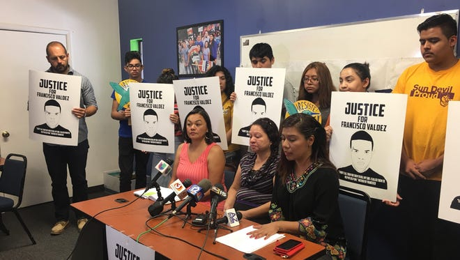 Lorenza Valdez, mother of Francisco Valdez, is flanked at the table by Francisca Porchas of Puente Arizona (left) and Viridiana Hernandez of the Center for Neighborhood Leadership at a press conference where they demanded action from Phoenix Police Chief Jeri Williams regarding the investigation into Francisco Valdez's death. The event was held at the Phoenix center June 27, 2017.