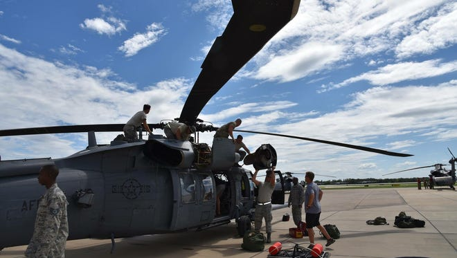 Members of the 920th Rescue Wing out of Patrick Air Force Base prepare to help victims of Hurricane Harvey in Texas.