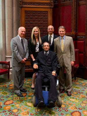 Ricky Palermo front, after receiving the Liberty Medal. Also pictured, left to right, are Sam Pontillo, Jackie Janes, Jim Palermo, and Senator Patrick Gallivan.