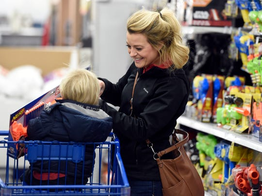 Christina Elrod of Evansville shops for Christmas gifts along with her son Parker, 2, at Meijer in Evansville Tuesday.  This year will be the first Black Friday at the Evansville store and like many retailers they will have special deals on Thanksgiving day as well.
