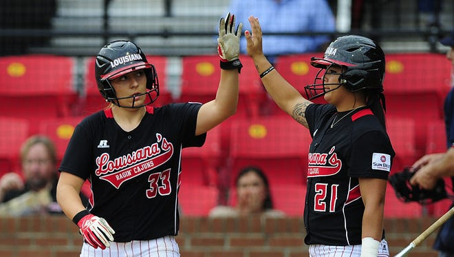 UL catcher Lexie Elkins (33) and Samantha Walsh (21) are two of the hot hitters for the Cajuns during their recent 13-game winning streak.  Paul Kieu/The Advertiser UL catcher Lexie Elkins (33) is congratulated by utility player Samantha Walsh (21) after Elkins scored a run off of a single by infielder Kelsey Vincent (28) during the sixth inning Wednesday.  Paul Kieu/The Advertiser UL catcher Lexie Elkins (33) is congratulated by utility player Samantha Walsh (21) after Elkins scored a run off of a single by infielder Kelsey Vincent (28) during the sixth inning of an NCAA softball game against Sam Houston State at Lamson Park in Lafayette, LA, Wednesday, March 19, 2014. UL defeated Sam Houston State 6-0 in the first game of the doubleheader on Wednesday.    Paul Kieu, The Advertiser