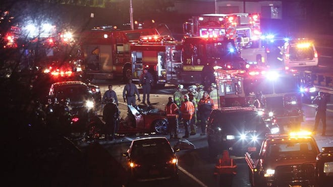 First responders from from White Plains, Purchase and Port Chester work at the scene of a serious auto accident on eastbound I-287 in White Plains Jan. 30, 2020. Firefighters had to extricated several people from the wreckage.
