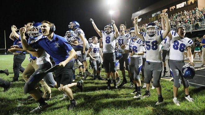 The Putnam County football team reacts after defeating rival Milan in overtime last year.