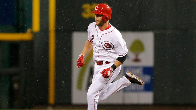 Cincinnati Reds shortstop Zack Cozart (2) runs to second base after hitting a double during the interleague baseball game between the Baltimore Orioles and the Cincinnati Reds, Thursday, April 20, 2017, at Great American Ball Park in Cincinnati.