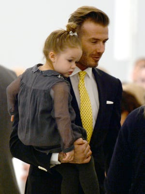 David Beckham and his daughter Harper arrive to watch the presentation of Victoria Beckham's fashions during the Mercedes-Benz Fashion Week Fall/Winter 2014 shows February 9, 2014 in New York City.