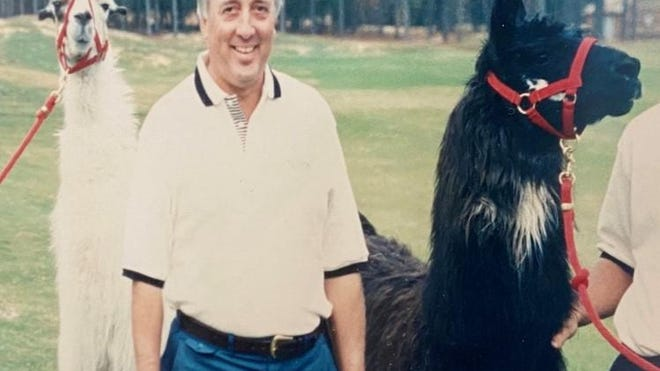 Architect Rees Jones surrounded by Talamore Resort's Dollie Llama and Billie Llama.