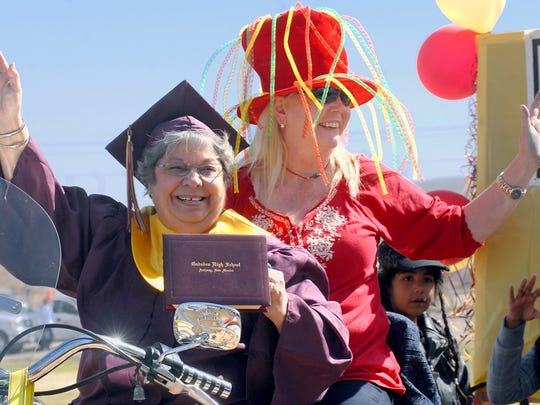 "Leap Year babies, Margaret Evaro, of La Mesa, N.M., front, and Valerie Phay, of Lancaster Calif., ride together on a float in Anthony, N.M., during the 201s Leap Year parade sponsored by the Anthony Lions Club. ""This is my 18th birthday and I am graduating from Gadsden High School!,"" said Evaro, four years ago."