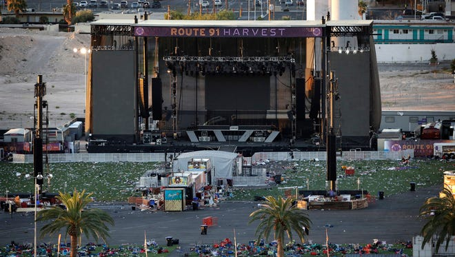 FILE - In this Tuesday, Oct. 3, 2017, file photo, debris litters a concert festival grounds after a mass shooting in Las Vegas. Legal action stemming from the mass shooting at the concert is picking up with lawsuits filed Wednesday, Nov. 15, on behalf of 14 concertgoers. (AP Photo/John Locher, File) ORG XMIT: NYAG305