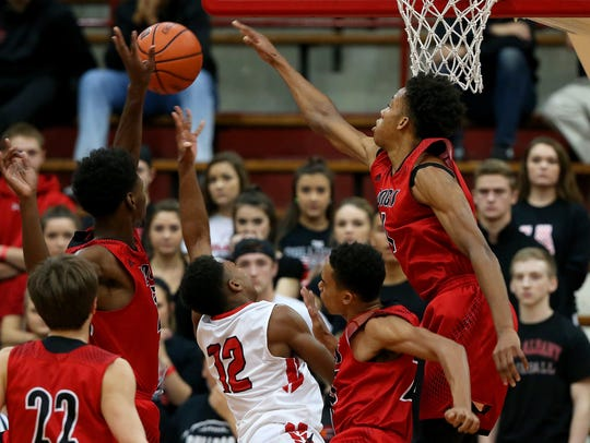 New Albany's Romeo Langford (1) blocks a shot by Pike's