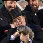 """Actor Bill Murray and friend in a scene from the 1993 motion picture """"Groundhog Day."""""""