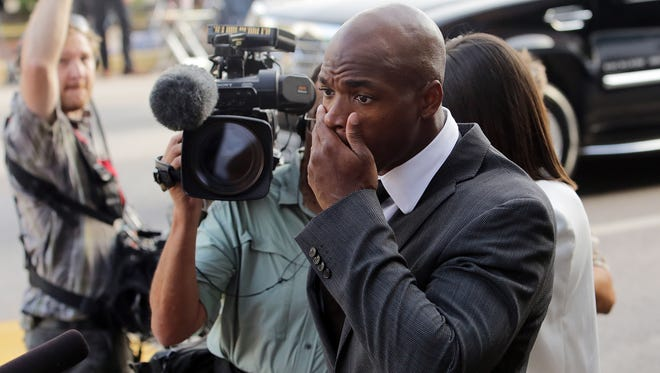 In this Oct. 8, 2014, file photo, Minnesota Vikings running back Adrian Peterson arrives at court in Conroe, Texas. The NFL suspended Peterson without pay for at least the remainder of the season on Tuesday.