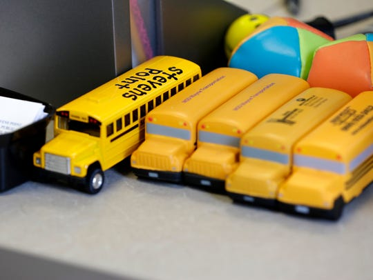 School buses adorn the office of Bradley Carriveau,