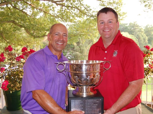 Al Rabil and Denver Brown of the Whippoorwill Club pose with the Wilson Cup at Scarsdale Golf Club.