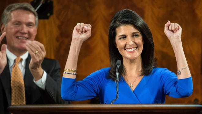 South Carolina Gov. Nikki Haley raises her fists to celebrate the recent Clemson football national championship while delivering the State of the State address at the state Capitol, Wednesday, Jan. 11, 2017, in Columbia, S.C.