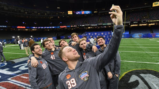 Clemson kicker Christian Groomes takes a selfie with the kickers during Clemson's media day at the Merceds-Benz Superdome in New Orleans on Saturday, December 30, 2017.