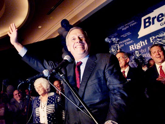 Phil Bredesen, center, acknowledges the cheers and applause of his supporters as he walks out onto the stage to accept victory for the Democratic ticket in the gubernatorial primary election night at Hilton Suites downtown Aug. 1, 2002.
