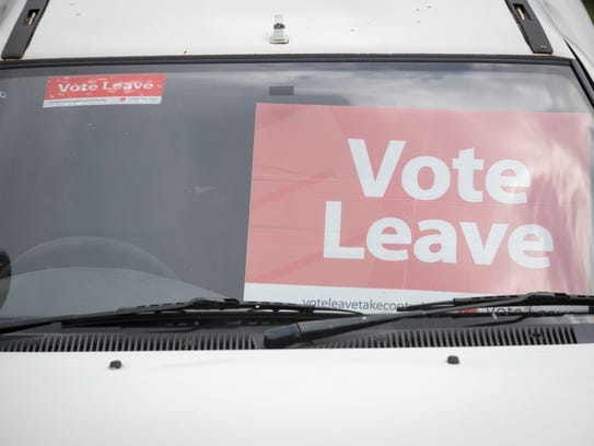 A Vote Leave poster is displayed inside a Ford Escort