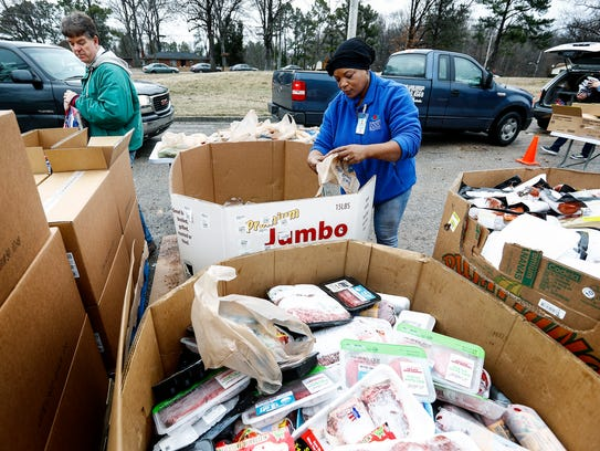 Mid-South Food Bank's Belynda Terry bags meat that