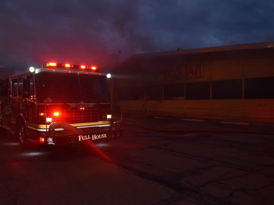 Indianapolis Fire Department Engine 44 sits in front of a northeast-side Family Dollar Stores location on Feb. 28, 2016. Investigators say the fire was intentionally set.