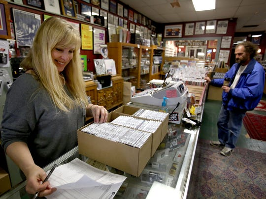 Lori Close, who co-owns Ranch Records with her husband, Kit, sorts through CDs on April 9. The store, which has been in business more than 30 years, will be participating in Record Store Day on April 18.