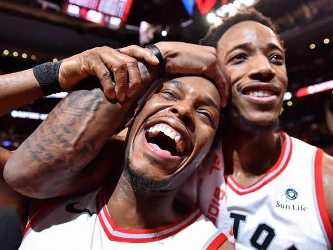 Kyle Lowry (left) and DeMar DeRozan celebrate the Raptors