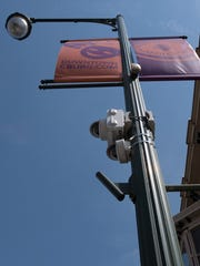 Security cameras mounted on light poles keep an eye