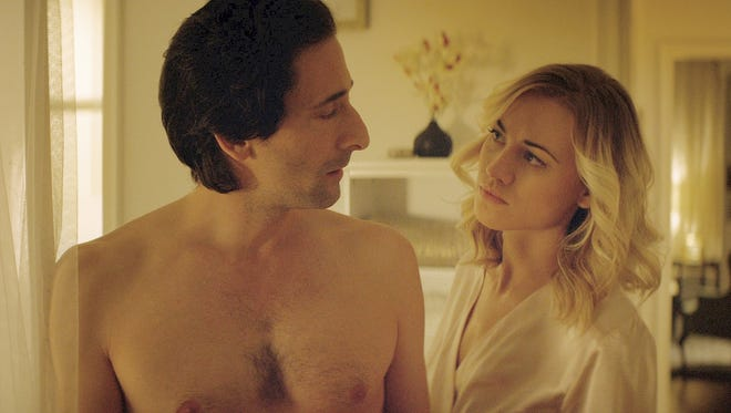 """A married newspaperman (Adrien Brody) stumbles into an affair with a stranger (Yvonne Strahovski) in the contemporary noir thriller  """"Manhattan Night."""""""