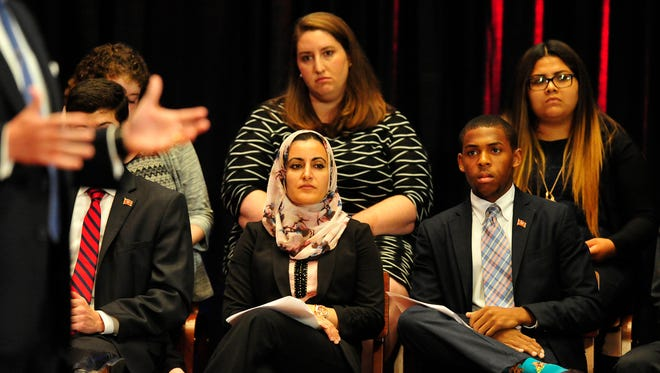 Suad Abdullah, of the Islamic Center of Nashville, and Belmont University student Kristoff Hart listen as Charles Robert Bone answers a question during a Nashforward debate in McAfee Concert Hall on the Belmont University campus in Nashville, Tenn. June 18, 2015.