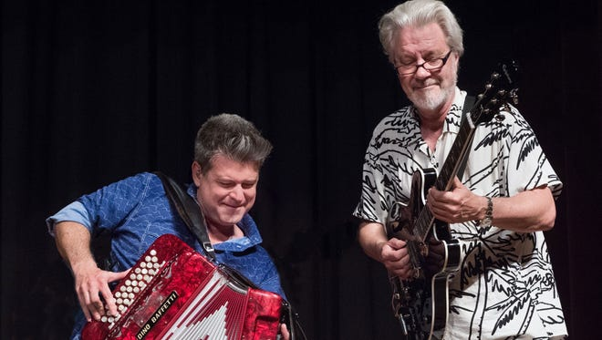 Steve Riley, left, and Sam Broussard jam at the Best of the Mamou Playboys show held last July at the Liberty Theater in Eunice.
