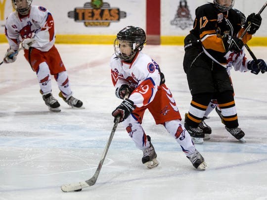 Port Huron Flyers' Braeden Bruyneel works the puck down ice during a Silver Stick PeeWee A hockey game Friday, Jan. 20, 2017 at McMorran Arena.