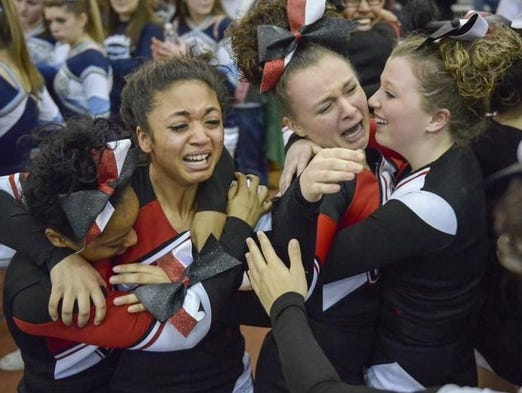The Geneva varsity cheerleading squad celebrates after winning the Section V Class A Championship at RIT's Gordon Field House on Saturday.