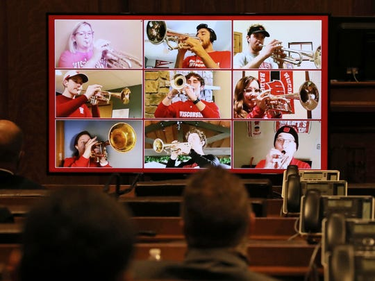 Members of the University of Wisconsin-Madison marching band perform virtually after Gov. Tony Evers' virtual State of the State address, as seen from the Assembly Chambers at the Wisconsin State Capitol in Madison on Tuesday.