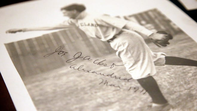 In this Jan. 22, 2015, photo, an autographed picture of Cleveland ball player Joe Jackson is shown at Heritage Auctions in Dallas. Sharon Bowen thought her late husband was a bit crazy for buying a scrapbook with a bunch of black and white photos of Cleveland ballplayers from the early 1900s, but not anymore. It turns out that scrapbook held what may be the only autographed photo of Shoeless Joe Jackson. (AP Photo/Tony Gutierrez)