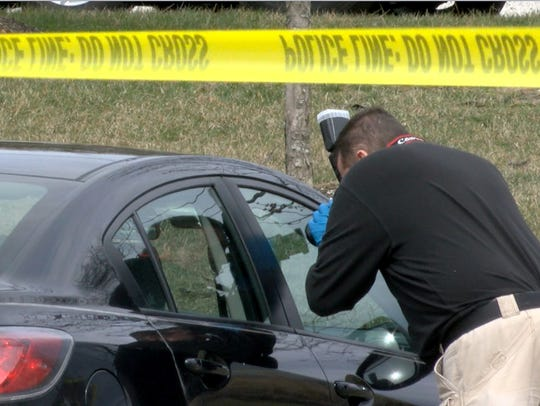A Monmouth County Prosecutors office investigator photographs