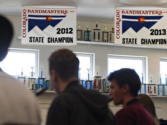 Trophies line the wall in the band room at Fossil Ridge High School on Wednesday, March 22, 2017.