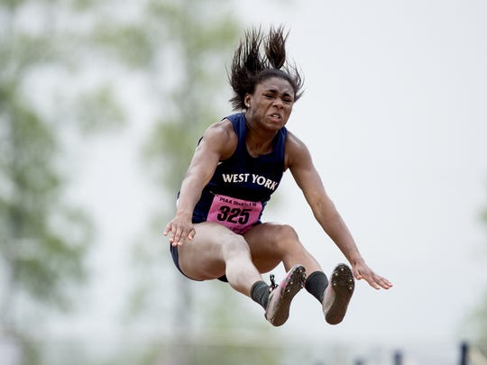 West York's Tesia Thomas competes in the Class AAA triple jump at the District III track and field championships held at Shipppensburg University, Friday, May 18, 2018.