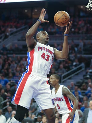 Pistons forward Anthony Tolliver rebounds against the Hornets during the third period of the Pistons' 112-105 win Friday at the Palace.