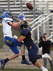 Regina's Jacob Phillips breaks up a pass intended for