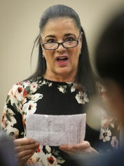 Gina Nichols confronts Larry Nassar on Wednesday, Jan. 17, 2018, in Circuit Judge Rosemarie Aquilina's courtroom during the second day of victim impact statements during his sentencing.  She also read a statement on behalf of her daughter Maggie Nichols, who was among the patients abused by the former sports medicine doctor. Nassar pleaded guilty to seven counts of sexual assault in Ingham County and three in Eaton County.