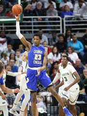 Grand Rapids Catholic Central's Marcus Bingham Jr. rebounds against New Haven in Friday's Class B state semifinal at Breslin Center.