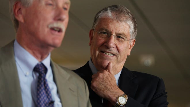 """Independent gubernatorial candidate Eliot Cutler, right, listens to US Sen. Angus King, left, speaks Monday, Aug. 18, 2014 in Portland, Maine during an event where King endorsed Cutler for Maine governor. King said there would be """"significant advantages"""" to having an independent governor who could make the best appointments, regardless of party affiliation. (AP Photo/Joel Page) ORG XMIT: MEJP105"""